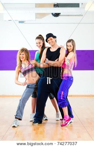 Man posing with woman in zumba dance school