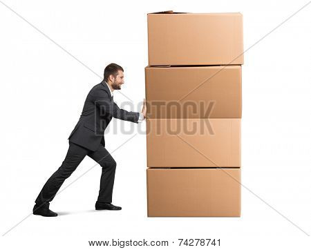 smiley businessman moving cardboard boxes. isolated on white background