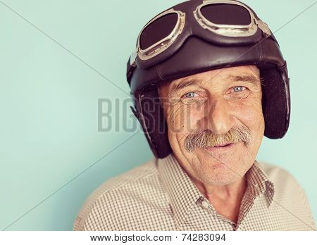 Senior funny man as a pilot with hat and glasses