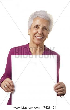 Attractive Senior Woman Holding Blank Billboard