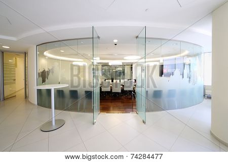 MOSCOW, RUSSIA - APR 10, 2014: Glass walls and open door to empty conference room in office of Moscow Exchange