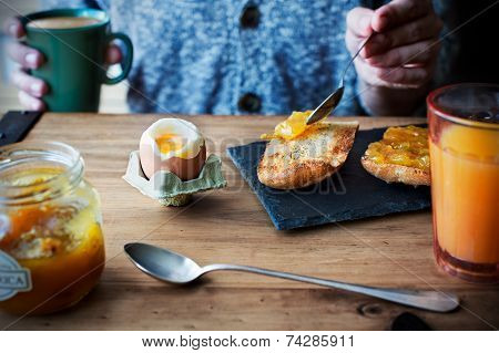 Breakfast With Soft Boiled Egg, Orange Juice, Toast With Jam And Coffee With Milk.