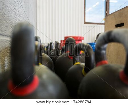 Selective focus of kettlebells at cross fitness box