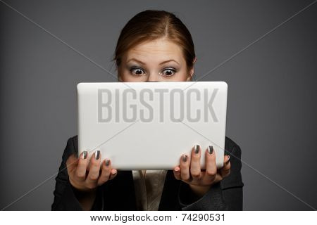 Surprised Woman With White Netbook