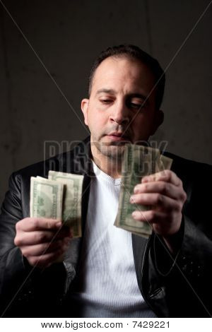 Man Counting His Money