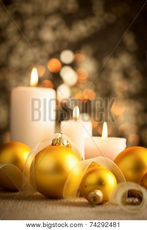 Christmas golden bokeh background with candlelight and baubles - vertical