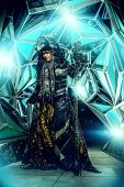 foto of shaman  - Portrait of a male shaman in ethnic dress on a background of a futuristic exterior - JPG