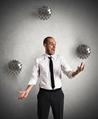 foto of juggler  - Concept of difficult business with a juggler businessman - JPG