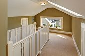 foto of upstairs  - Upstairs hallway with vaulted ceiling and skylight - JPG