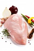 picture of turkey-hen  - Raw turkey fillet and vegetables on white background - JPG