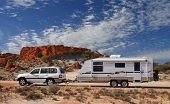 stock photo of four-wheel  - Four wheel drive and large offroad caravan  - JPG