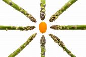 stock photo of kumquat  - Eight green asparagus spears aligned along the vertical horizontal and diagonal picture axes - JPG