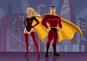 pic of heroin  - Male and female superheroes posing in front of cityscape - JPG