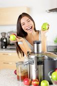 ������, ������: Apple juice Woman making apple juice on juicer machine at home in kitchen Juicing and healthy eat