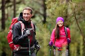 image of multicultural  - Hiking man and woman on hike in forest trekking - JPG