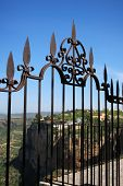 image of ironworker  - Ornate ironwork fence with views over part of the town and gorge Ronda Andalusia Western Europe - JPG