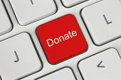 foto of soliciting  - Red donate button on the keyboard close - JPG