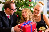 picture of boxing day  - Parents and daughter with Christmas gifts on boxing day - JPG
