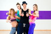 pic of zumba  - Man posing with woman in zumba dance school - JPG