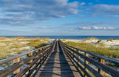 stock photo of alabama  - A wooden walkway to the Gulf of Mexico on the Alabama Gulf Coast - JPG