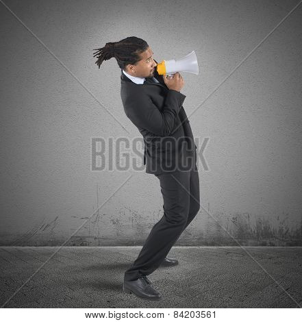 Businessman fearful use the megaphone