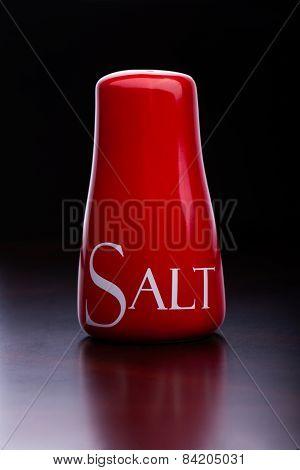 Closeup Of Red Salt-cellar On Darck Background By Cristina Arpentina