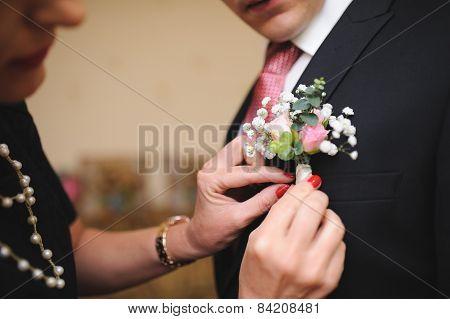 Pinning a Boutonniere