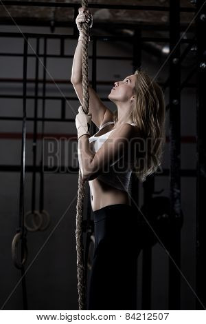 Fitness Woman During Rope Climbing