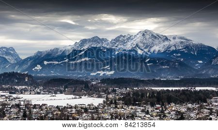Panoramic View On Austrian Alps Covered By Snow At Cloudy Day
