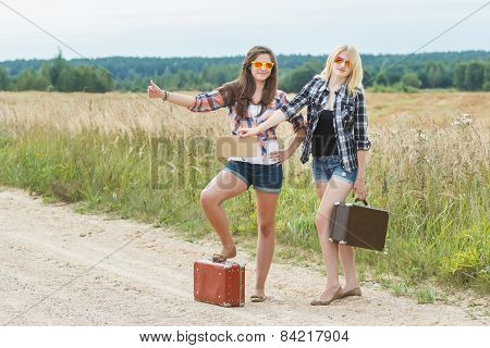 Students Wearing Sunglasses Hitchhike On Road