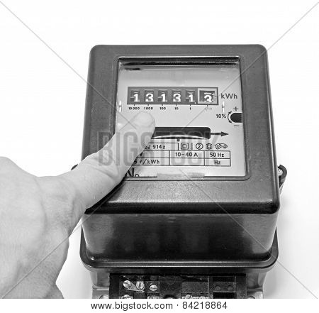 Finger Indicating The Number On The Counter Of Electricity