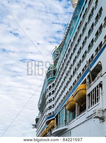 Yellow Lifeboats On Side Of Cruise Ship