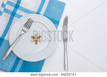 Pills on white plate