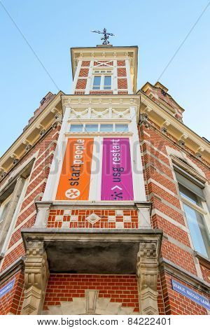 Beautiful Old House With Advertising On The Facade In Dutch City Of Den Bosch