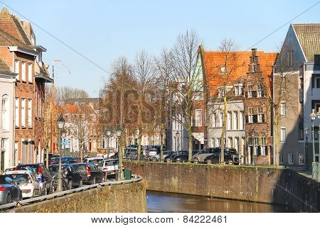 Cars Parking On Canal Embankment  In The Dutch Town Den Bosch.