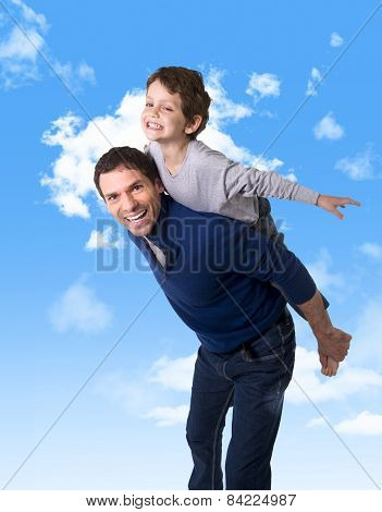 Young Happy Brazilian Father Carrying On His Back  Little Son As Airplane Flying Having Fun Together