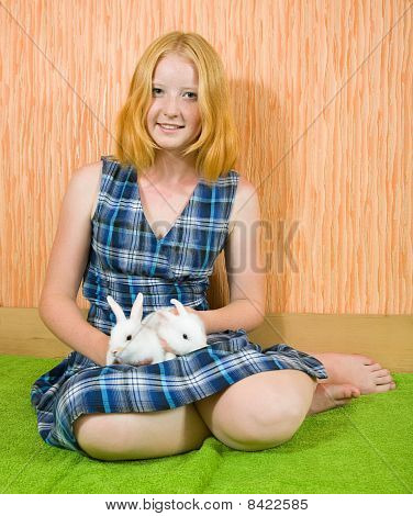 Girl With Two  Rabbits  In Home