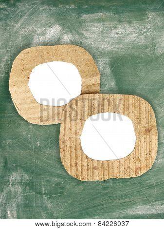 Two Blank Cardboard Frames On Grunge Chalkboard