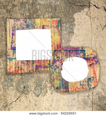 Two Blank Colorful Painted Cardboard Frames On Grunge Wall