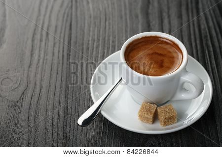 cup of freshly made espresso on wood board