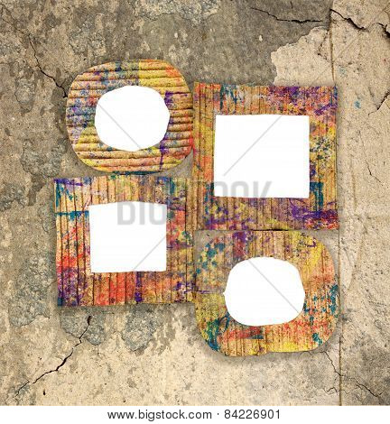 Group Of Blank Colorful Painted Cardboard Frames On Grunge Wall