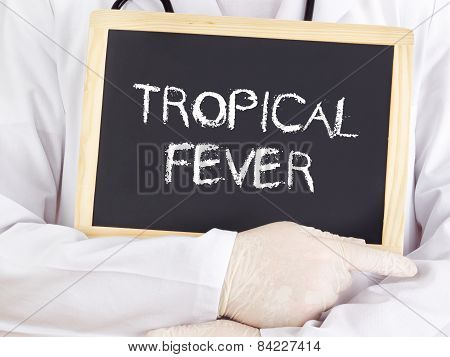 Doctor Shows Information On Blackboard: Tropical Fever