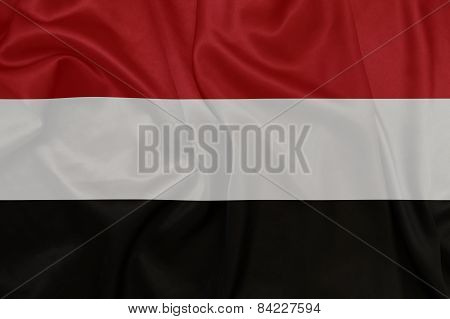 Yemen - Waving national flag on silk texture