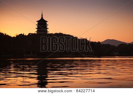Chinese Pagoda On Orange Evening Sky Background