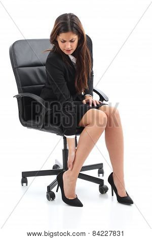 Businesswoman Sitting And Suffering Feet Ache