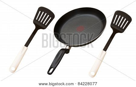 Two Kitchen Spatulas And Frying Pan For Cooking