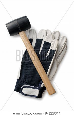 Rubber Hammer And Gloves On A White Background