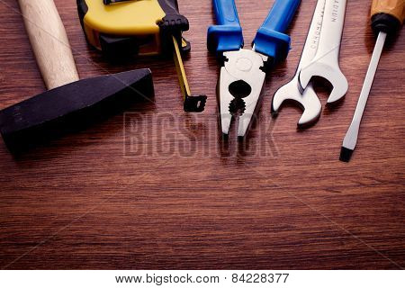 Assorted Hand Work Tools On A Wooden Table