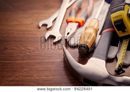 Close Up Hand Tools On The Wooden Table