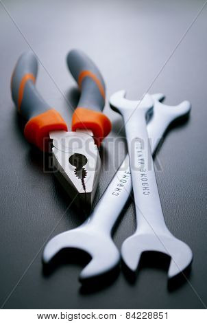 Pliers And Wrenches Hand Tools On Gray Background